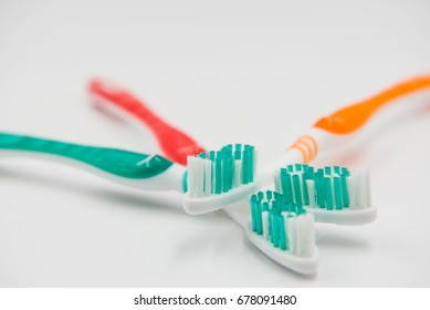 Closeup new toothbrushes isolated on a white background.