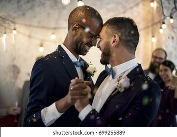 Closeup of Newlywed Gay Couple Dancing on Wedding Celebration