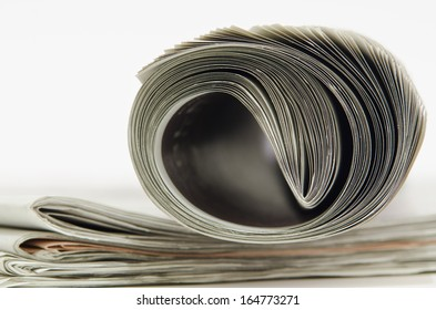 closeup of newspaper on white background