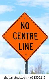 Closeup of a no centre line sign.