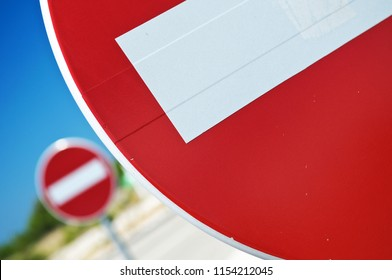 Closeup of no entry one-way traffic sign