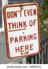 Closeup of no parking sign. Vertical shot.