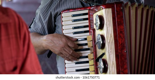 Closeup of Northeastern accordionist fingering the keys of his musical instrument. Sao Paulo, Brazil