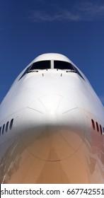 A closeup of the nose of a jumbo jet.