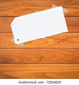 closeup of note paper on wooden background