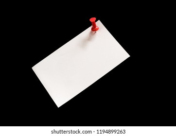Close-up note paper  and Red pushpin   isolated on black background with copy space