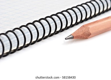 Close-up of notebook and pencil