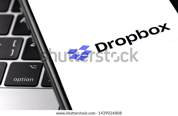 closeup notebook and smartphone with Dropbox logo on the display. Dropbox is file hosting company Dropbox Inc. Moscow, Russia - June 27, 2019