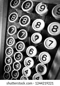 Closeup of numbers on cash register in black and white.