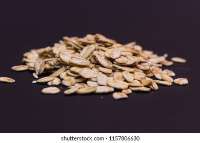Close-up of oat flakes on black background