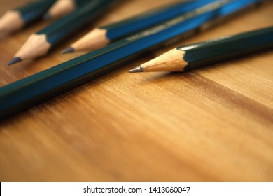 Close-up off design pens on wood background