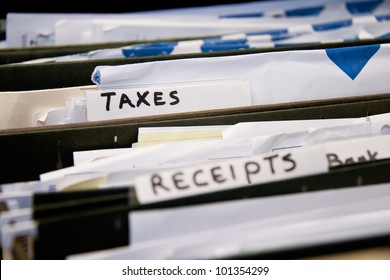 Close-up of an office shelves full of different files, focus on Taxes