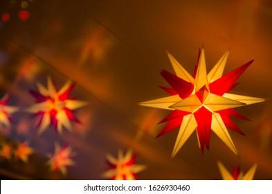 Close-up ofiIlluminated Herrnhut stars. Traditional christmas decoration in Saxony, Germany