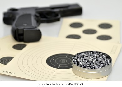 Close-up og air gun pellets and air pistol
