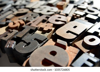 a closeup ohoto of mixed sets of vintage wooden letterpress