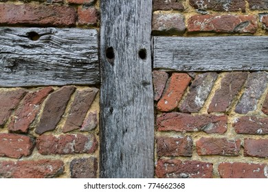 Close-up from old ancient wall with hardwood and red historic bricks background