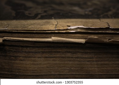 Closeup of an old book. Fragment of an old book page. Closeup of old book pages texture .