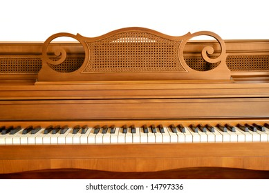 Closeup of an old console piano. Upper portion isolated on white. Would work well for a grunge project.