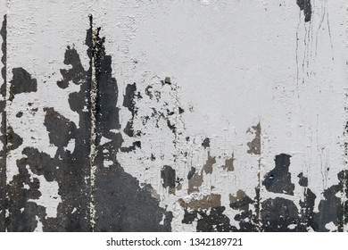 close-up of old cracked paint on the gray concrete wall with space for text. Texture, pattern, background. The wall cracked with paint, abstract dart gray behind the paint.
