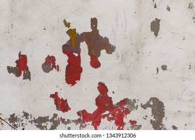 close-up of old cracked paint on the concrete wall. Texture, pattern, background. The wall cracked with paint, abstract red and brown color paint under the white