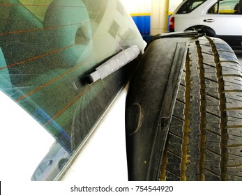closeup of an old and dusty tire fixed at the back of a four wheel car