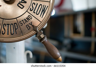 """Closeup of an old engine order telegraph on """"stand by"""" between """"Stop"""" and """"Slow"""""""