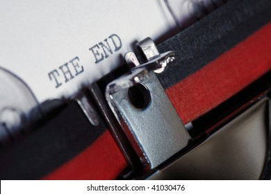 "Close-up of an old fashioned antique typewriter with the words ""the end"""