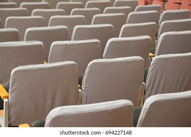 Closeup of old grey seats in cinema