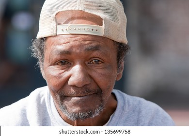 Closeup of old homeless African American Man outdoors