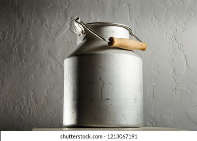 closeup old kind of aluminum bidon for milk storage stands on kitchen table