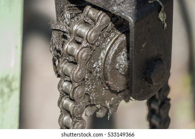 Close-up Old machine engine cog wheel with chain