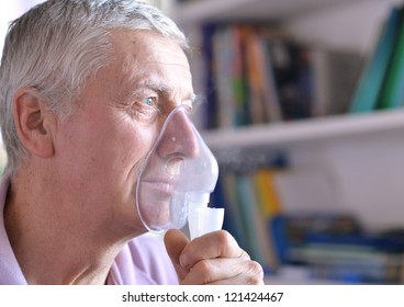 close-up of an old man doing inhalation