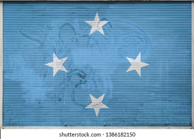 Close-up of old metal wall with national flag of Federated States of Micronesia. Concept of Federated States of Micronesia export-import, storage of goods and national delivery of goods.
