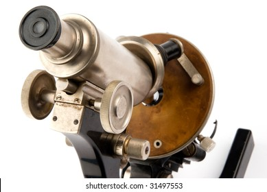 closeup old microscope on white background