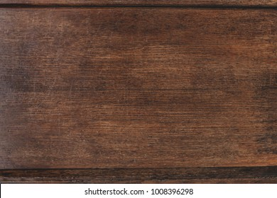 Closeup of old natural wood grunge texture. Dark surface with old natural wooden pattern. Vintage wooden floor. Rustic table top view with copy space for text.