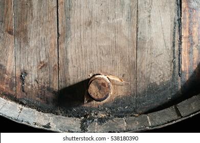 Closeup of old oak barrel. Front view.