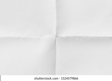 Close-up of old paper folded in four, texture background