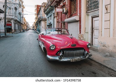 Close-up of old pink Chevrolet parked on Havana street. American classic cars very typical of Cuba.