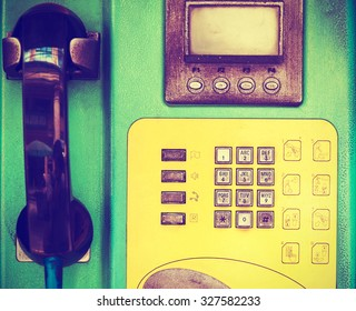 closeup of old public telephone in phonebooth