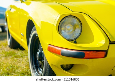 Closeup of old retro yellow car headlight