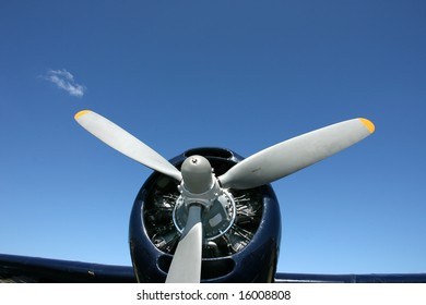 Closeup of an old Rotary Engine and prop over a blue sky