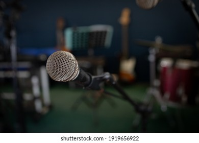 Closeup to an old rusty microphone on music stage