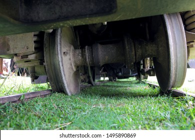 Close-up of the old rusty narrow-gauge train wheels derailed, the train is responsible for transportation from Janakpur, Nepal to the Jaynagar Railway in India.