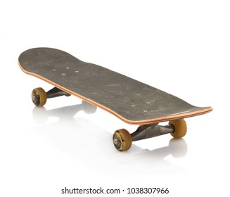 Close-up Of Old Skateboard Isolated Over White Background