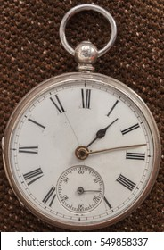 Close-up of an old sterling silver pocket watch