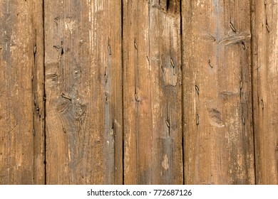 Close-up of old, textured, rustic, weathered, brown wood.