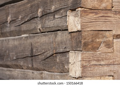 Closeup of an old timber wall made of large tree trunks