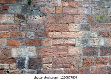 Closeup of old wall made of sandstone bricks