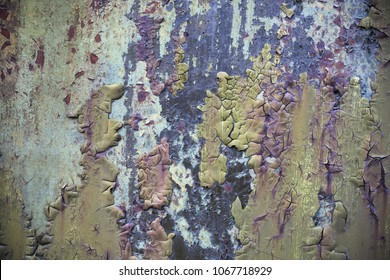 Closeup of old weathered cracked paint surface on wall