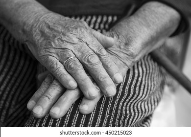 Close-up of old womans hands, black and white